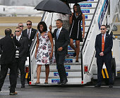 First lady Michelle Obama President Barack Obama Malia Obama and Sasha Obama arrive at Jose Marti International Airport for a 48hour visit on...