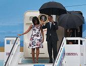 First lady Michelle Obama President Barack Obama Malia Obama and Sasha Obama arrive at Jose Marti International Airport for a 48hour visit on...