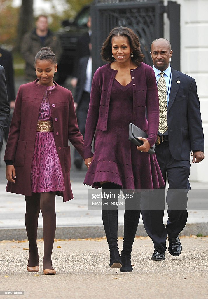 US First Lady Michelle Obama President walks with daughter Sasha from the White House, across Lafayette Park to Saint John's Episcopal Church for Sunday services on October 27, 2013 in Washington, DC. AFP PHOTO/Mandel NGAN