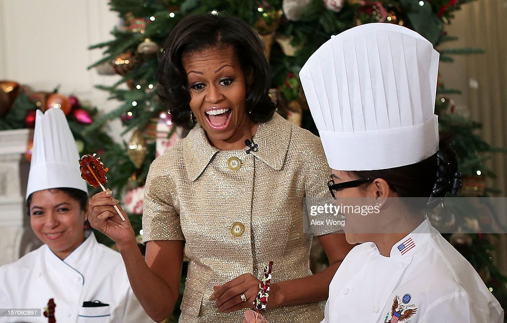 U.S. first lady <a gi-track='captionPersonalityLinkClicked' href=/galleries/search?phrase=Michelle+Obama&family=editorial&specificpeople=2528864 ng-click='$event.stopPropagation()'>Michelle Obama</a> reacts as she participates in craft activities with military children at the State Dining Room after a preview of the 2012 White House holiday decorations November 28, 2012 at the White House in Washington, DC. The first lady welcomed military families, including Gold Star and Blue Star parents, spouses and children, to the White House for the first viewing of the 2012 holiday decorations. The theme for the White House Christmas 2012 is 'Joy to All.'