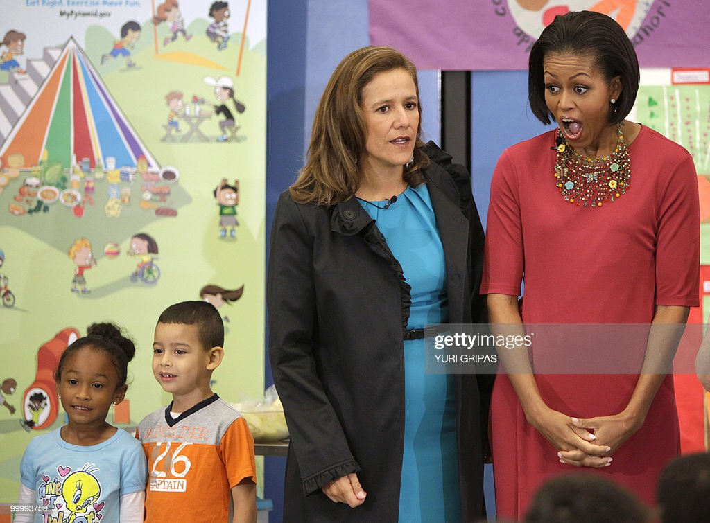 US First Lady Michelle Obama (R) reacts next to Mexican first lady Margarita Zavala during a lunch at New Hampshire Elementary School in Silver Spring, Maryland on May 19, 2010.