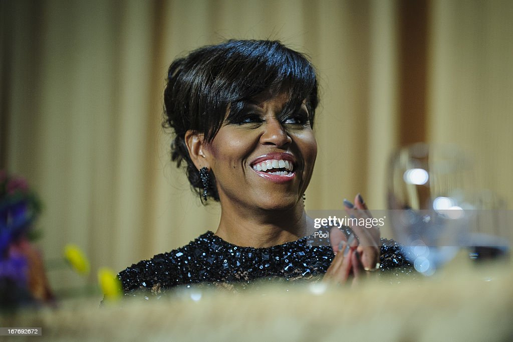 First lady Michelle Obama reacts to a joke told by comedian Conan O'Brien during the White House Correspondents' Association Dinner on April 27, 2013 in Washington, DC. The dinner is an annual event attended by journalists, politicians and celebrities.