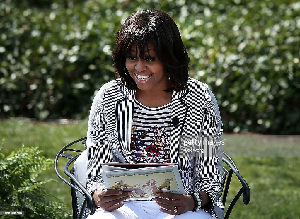 U.S. first lady Michelle Obama reads the story 'Cloudy with a Chance of Meatballs' to children during the annual White House Easter Egg Roll on the South Lawn of the White House April 1, 2013 in Washington, DC. President Barack Obama and first lady Michelle Obama hosted thousands of people during the annual celebration of Easter.