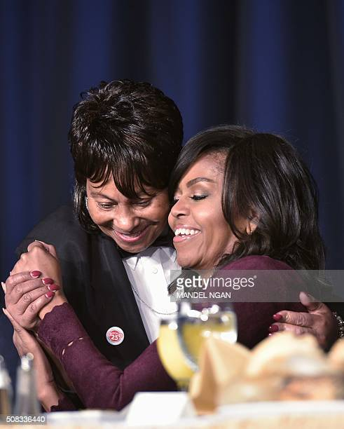 US First Lady Michelle Obama receives a hug from a waitress during the National Prayer Breakfast on February 42016 in Washington DC President Barack...
