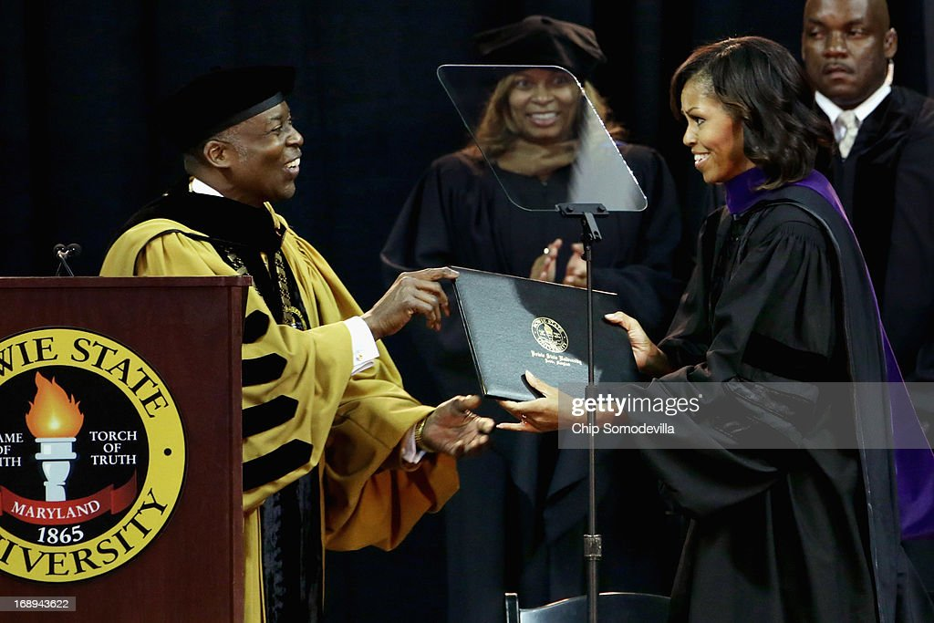 First lady Michelle Obama (R) receives her honarary degree from Bowie State University President Mickey Burnim (L) during the university's graduation ceremony at the Comcast Center on the campus of the University of Maryland May 17, 2013 in College Park, Maryland. Obama received and Honorary Doctor of Laws degree before addressing the 600 graduates of Maryland's oldest historically black university and one of the ten oldest in the country.