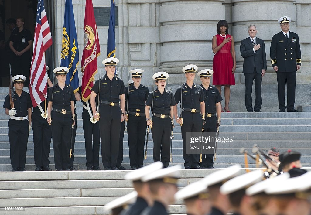 US First Lady Michelle Obama reviews a troop formation alongside Secretary of the Navy Ray Mabus (2nd R) prior to lunch at the US Naval Academy in Annapolis, Maryland on April 17, 2013. Obama traveled to Annapolis to join Maryland Governor Martin O'Malley at a bill signing for the Veterans Full Employment Act of 2013, supporting military veterans in licensing, training, education and employment. AFP PHOTO / Saul LOEB