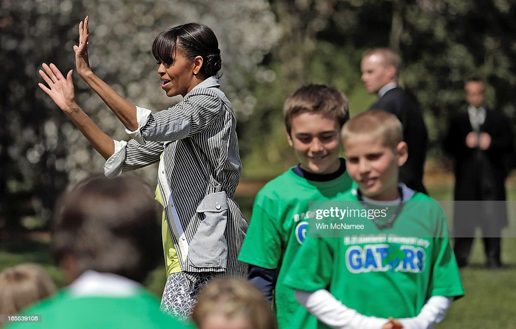 U.S. first lady Michelle Obama says goodbye to schoolchildren after planting the White House Kitchen Garden on the South Lawn of the White House April 4, 2013 in Washington, DC. For the fifth time, the first lady invited students from 'schools that have made exceptional improvements to school lunches' from Florida, Massachusetts, Tennessee and Vermont to help her plant the garden.