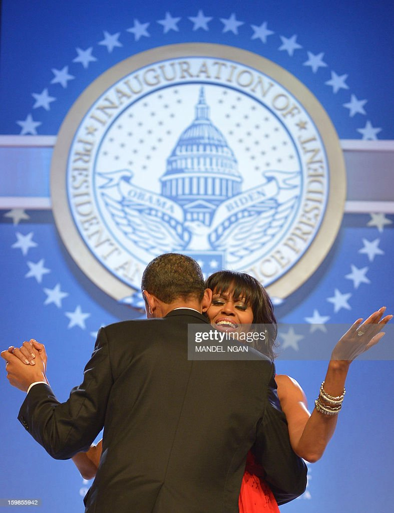 First Lady Michelle Obama sings along to 'Lets Stay Together' performed by Jennifer Hudson while dancing with US President Barack Obama during the Inaugural Ball at the Walter E. Washington Convention Center on January 21, 2013 in Washington, DC. AFP PHOTO/MANDEL NGAN