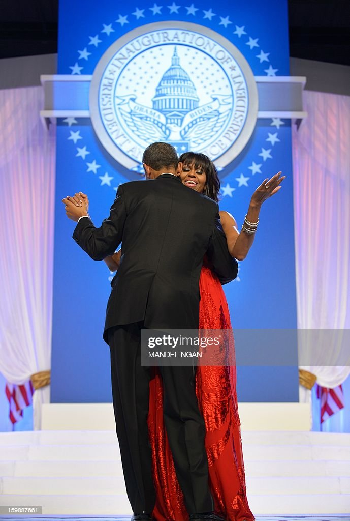 First Lady Michelle Obama sings along to 'Lets Stay Together' performed by Jennifer Hudson while dancing with US President Barack Obama during the Inaugural Ball at the Walter E. Washington Convention Center on January 21, 2013 in Washington, DC.