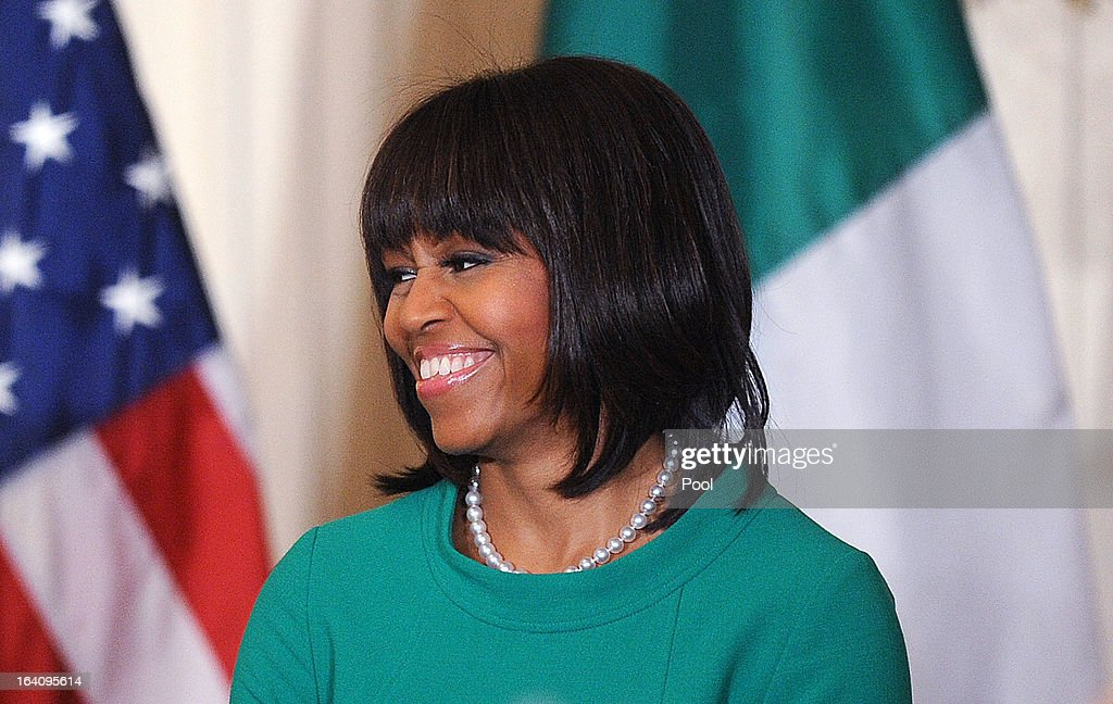 U.S. First lady <a gi-track='captionPersonalityLinkClicked' href=/galleries/search?phrase=Michelle+Obama&family=editorial&specificpeople=2528864 ng-click='$event.stopPropagation()'>Michelle Obama</a> smiles during a reception for Ireland's prime minister in the East Room of the White House on March 19, 2013 in Washington, DC. President Obama met with Irish Prime Minister Enda Kenny prior to the annual St. Patrick's Day lunch hosted at the Capitol.