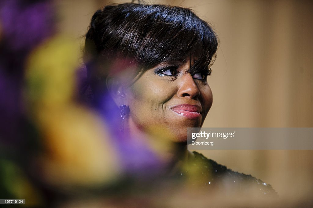 First Lady <a gi-track='captionPersonalityLinkClicked' href=/galleries/search?phrase=Michelle+Obama&family=editorial&specificpeople=2528864 ng-click='$event.stopPropagation()'>Michelle Obama</a> smiles during the White House Correspondents' Association (WHCA) dinner in Washington, District of Columbia, U.S., on Saturday, April 27, 2013. The 99th annual dinner raises money for WHCA scholarships and honors the recipients of the organization's journalism awards. Photographer: Pete Marovich/Bloomberg via Getty Images