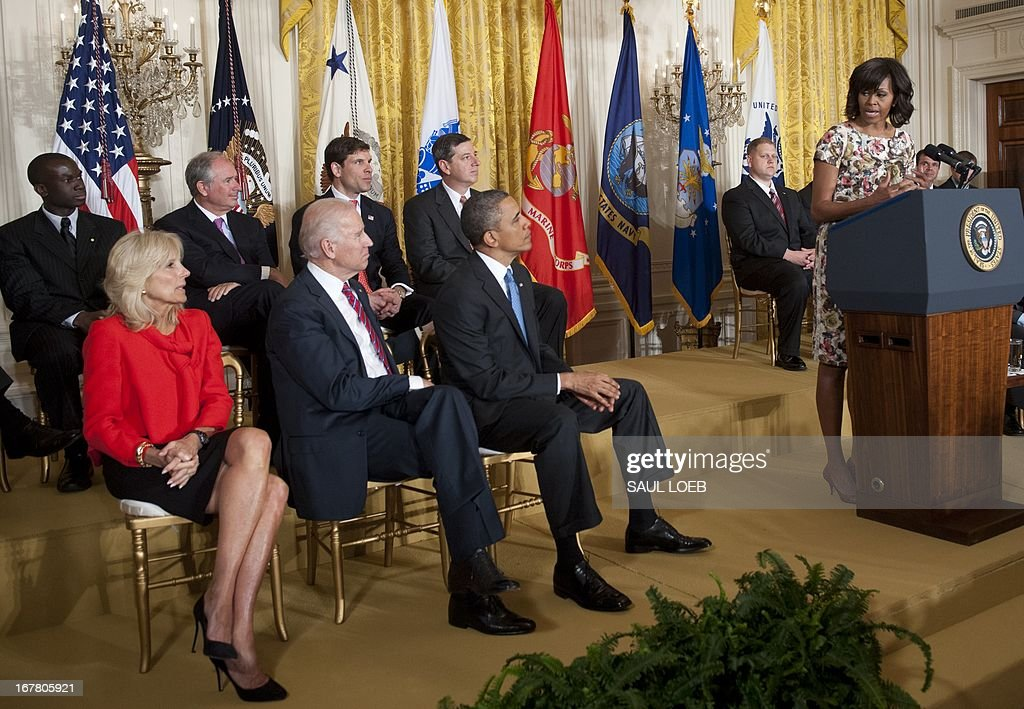US First Lady Michelle Obama (R) speaks alongside US President <a gi-track='captionPersonalityLinkClicked' href=/galleries/search?phrase=Barack+Obama&family=editorial&specificpeople=203260 ng-click='$event.stopPropagation()'>Barack Obama</a> (2nd R), US Vice President Joe Biden (2nd L) and his wife, Jill Biden (L), during an event highlighting Joining Forces hiring initiative for military veterans and spouses in civilian jobs in the East Room of the White House in Washington on April 30, 2013. Since President Obama challenged American businesses to hire US military veterans and spouses in August 2011, they have hired or trained 290,000 military veterans and spouses and now pledge to hire or train an additional 435,000 veterans and military spouses by 2018. AFP PHOTO / Saul LOEB
