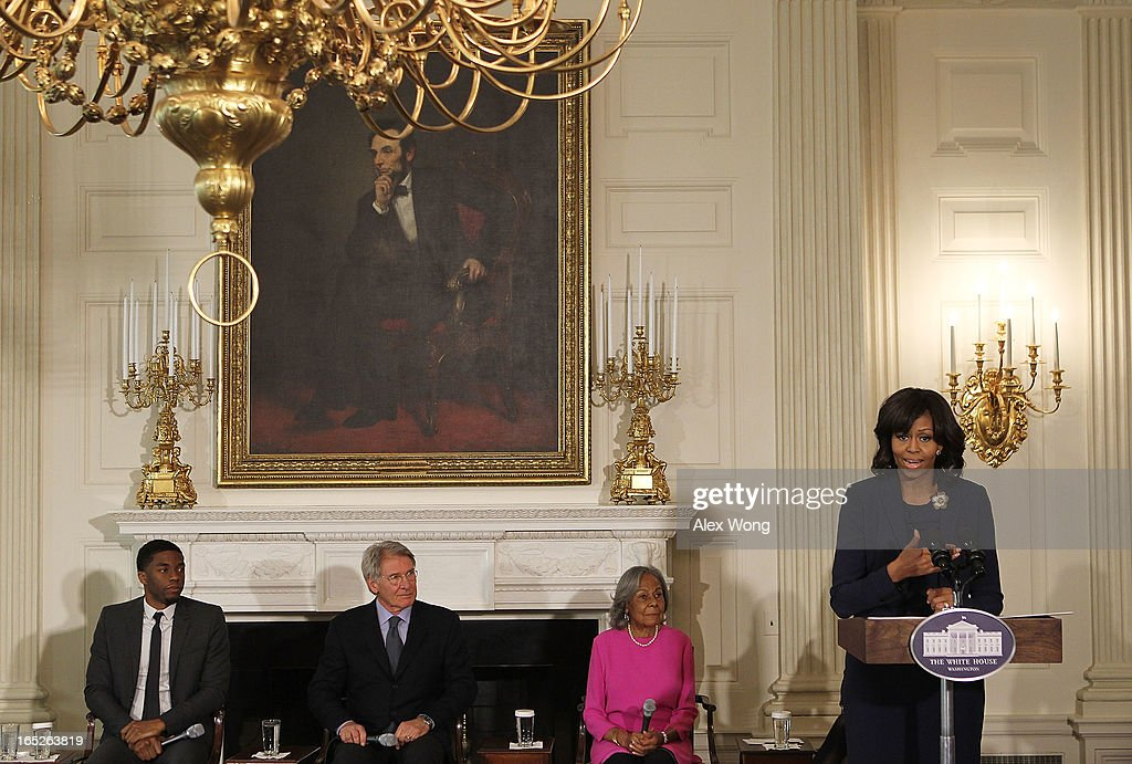 U.S. first lady <a gi-track='captionPersonalityLinkClicked' href=/galleries/search?phrase=Michelle+Obama&family=editorial&specificpeople=2528864 ng-click='$event.stopPropagation()'>Michelle Obama</a> speaks as (L-R) actors <a gi-track='captionPersonalityLinkClicked' href=/galleries/search?phrase=Chadwick+Boseman&family=editorial&specificpeople=8825549 ng-click='$event.stopPropagation()'>Chadwick Boseman</a>, <a gi-track='captionPersonalityLinkClicked' href=/galleries/search?phrase=Harrison+Ford+-+Actor+-+Born+1942&family=editorial&specificpeople=11508906 ng-click='$event.stopPropagation()'>Harrison Ford</a>, and <a gi-track='captionPersonalityLinkClicked' href=/galleries/search?phrase=Rachel+Robinson&family=editorial&specificpeople=93975 ng-click='$event.stopPropagation()'>Rachel Robinson</a>, widow of the late baseball player Jackie Robinson, listen during a State Dining Room event April 2, 2013 at the White House in Washington, DC. The first lady made remarks during an interactive student workshop with the cast and crew of the movie '42,' a biographical film about Jackie Robinson, the first African American player in Major League Baseball.