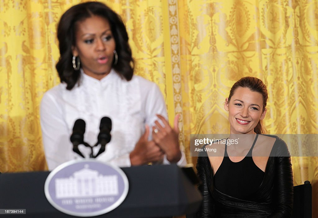 U.S. first lady <a gi-track='captionPersonalityLinkClicked' href=/galleries/search?phrase=Michelle+Obama&family=editorial&specificpeople=2528864 ng-click='$event.stopPropagation()'>Michelle Obama</a> (L) speaks as actress <a gi-track='captionPersonalityLinkClicked' href=/galleries/search?phrase=Blake+Lively&family=editorial&specificpeople=221673 ng-click='$event.stopPropagation()'>Blake Lively</a> (R) listens during a workshop for high school students from DC, New York and Boston about careers in film production November 8, 2013 at the East Room of the White House in Washington, DC. Students had an opportunity to hear from leaders in the industry about animation, special effects, makeup, costume, directing, music and sound effects.