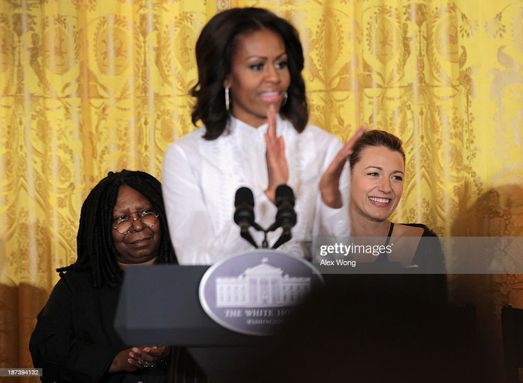 U.S. first lady <a gi-track='captionPersonalityLinkClicked' href=/galleries/search?phrase=Michelle+Obama&family=editorial&specificpeople=2528864 ng-click='$event.stopPropagation()'>Michelle Obama</a> speaks as actress <a gi-track='captionPersonalityLinkClicked' href=/galleries/search?phrase=Whoopi+Goldberg&family=editorial&specificpeople=202463 ng-click='$event.stopPropagation()'>Whoopi Goldberg</a> (L), and actress <a gi-track='captionPersonalityLinkClicked' href=/galleries/search?phrase=Blake+Lively&family=editorial&specificpeople=221673 ng-click='$event.stopPropagation()'>Blake Lively</a> (R) listen during a workshop for high school students from DC, New York and Boston about careers in film production November 8, 2013 at the East Room of the White House in Washington, DC. Students had an opportunity to hear from leaders in the industry about animation, special effects, makeup, costume, directing, music and sound effects.