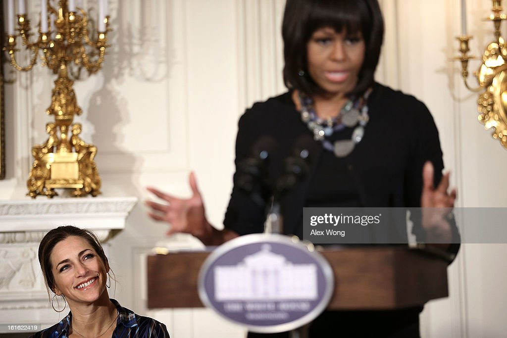 First lady Michelle Obama (R) speaks as Executive Director of President's Commission on Arts and the Humanities Rachel Goslins (L) listens during an interactive student workshop with the cast and crew of the film Beasts of the Southern Wild at the State Dining Room of the White House February 13, 2013 in Washington, DC. The first lady hosted middle and high school students from the DC area and New Orleans to participate in the event.