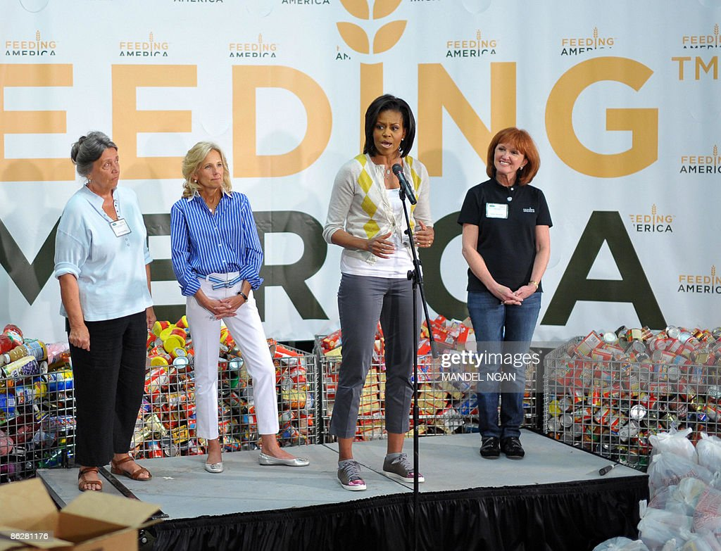 US First Lady Michelle Obama speaks as Jill Biden the wife of Vice President Joe Biden Lynn Brantley Executive Director Capitol Area Food Bank and...