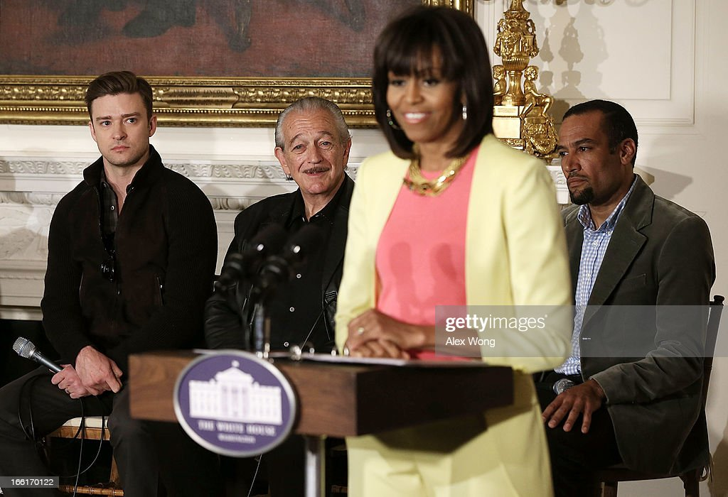 U.S. first lady Michelle Obama speaks as musicians (L-R) Justin Timberlake, Charlie Musselwhite, and Ben Harper listen during an interactive student workshop at the State Dining Room of the White House April 9, 2013 in Washington, DC. The first lady hosted middle and high school students from across the country to take part in the workshop on 'Soulsville,