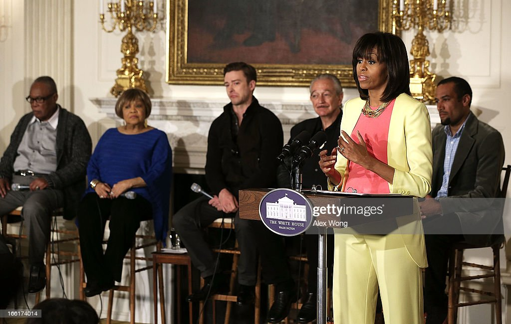 U.S. first lady Michelle Obama speaks as musicians (L-R) Sam Moore, Mavis Staples, Justin Timberlake, Charlie Musselwhite, and Ben Harper listen during an interactive student workshop at the State Dining Room of the White House April 9, 2013 in Washington, DC. The first lady hosted middle and high school students from across the country to take part in the workshop on 'Soulsville,