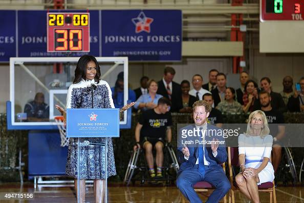 First Lady Michelle Obama speaks as Prince Harry and Dr Jill Biden listen at the Joining Forces Invictus Games Event at Wells Field House on October...