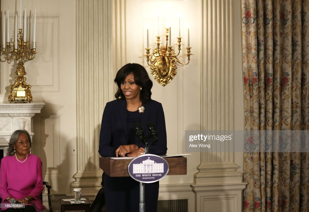 U.S. first lady <a gi-track='captionPersonalityLinkClicked' href=/galleries/search?phrase=Michelle+Obama&family=editorial&specificpeople=2528864 ng-click='$event.stopPropagation()'>Michelle Obama</a> speaks as <a gi-track='captionPersonalityLinkClicked' href=/galleries/search?phrase=Rachel+Robinson&family=editorial&specificpeople=93975 ng-click='$event.stopPropagation()'>Rachel Robinson</a>, widow of the late baseball player Jackie Robinson, listens during a State Dining Room event April 2, 2013 at the White House in Washington, DC. The first lady made remarks during an interactive student workshop with the cast and crew of the movie '42,' a biographical film about Jackie Robinson, the first African American player in Major League Baseball.