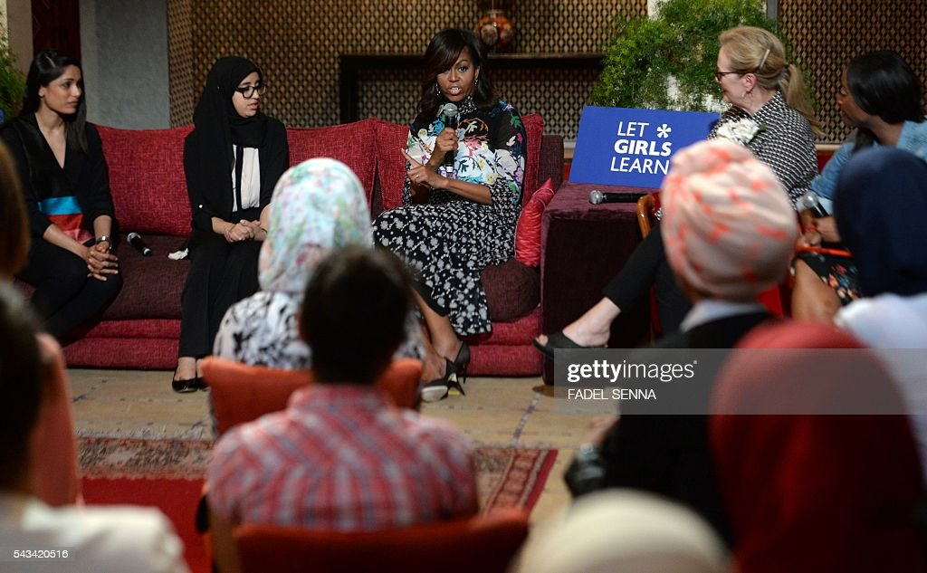 US first lady Michelle Obama (C) speaks as she meets Moroccan young women following the 'Let Girls Learn' Program on June 28, 2016 in the Western Moroccan city of Marrakesh. US First Lady Michelle Obama began a two day visit to Morocco to participate in a CNN-moderated conversation with adolescent girls on the challenges they face in getting a quality education. / AFP / FADEL