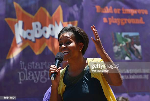 S first lady Michelle Obama speaks before helping to construct a playground at the Imagine Southeast Public Charter Elementary School June 15 2011 in...