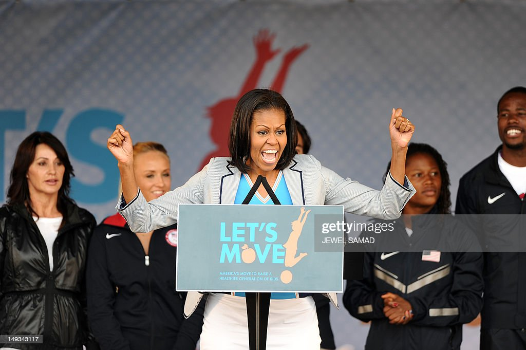 US First Lady Michelle Obama speaks during a 'Let's Move-London' event at the Winfield House in London on July 27, 2012, hours before the official start of the London 2012 Olympic Games.