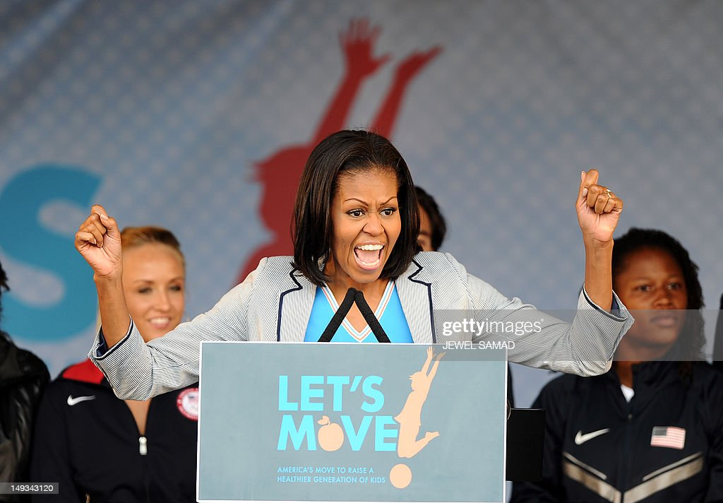 US First Lady Michelle Obama speaks during a 'Let's Move-London' event at the Winfield House in London on July 27, 2012, hours before the official start of the London 2012 Olympic Games. AFP PHOTO / JEWEL SAMAD
