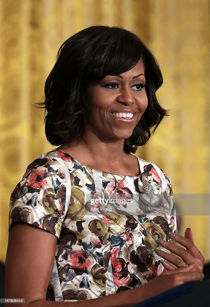 U.S. first lady <a gi-track='captionPersonalityLinkClicked' href=/galleries/search?phrase=Michelle+Obama&family=editorial&specificpeople=2528864 ng-click='$event.stopPropagation()'>Michelle Obama</a> speaks during a veterans employment event in the East Room April 30, 2013 at the White House in Washington, DC. <a gi-track='captionPersonalityLinkClicked' href=/galleries/search?phrase=Michelle+Obama&family=editorial&specificpeople=2528864 ng-click='$event.stopPropagation()'>Michelle Obama</a> and Jill Biden encousrged the private sector to step up the hiring of veterans.