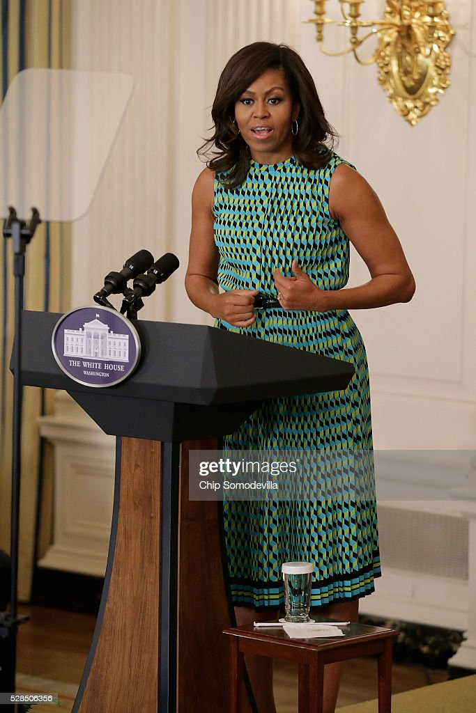 U.S. first lady Michelle Obama speaks during an event announcing commitments from more than 50 companies that have pledged to hire and train veterans and military spouses in the State Dining Room at the White House May 5, 2016 in Washington, DC. On the fifth anniversary of Obama and Dr. Jill Biden's military hiring initiative Joining Forces, Amazon founder and CEO Jeff Bezos announced a commitment by his company to hire 25,000 more military veterans in the next five years.
