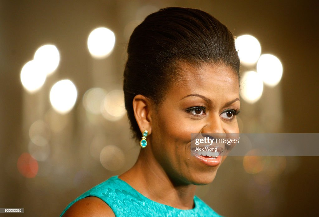 U.S. first lady <a gi-track='captionPersonalityLinkClicked' href=/galleries/search?phrase=Michelle+Obama&family=editorial&specificpeople=2528864 ng-click='$event.stopPropagation()'>Michelle Obama</a> speaks during the media preview of the White House holiday decorations December 2, 2009 at the White House in Washington, DC. The theme for the 2009 White House holiday decorations is 'Reflect Rejoice Renew.'