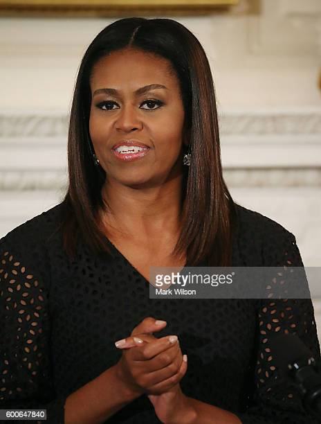First lady Michelle Obama speaks during the President's Committee on the Arts and the Humanities poetry reading to honor student poets at the White...