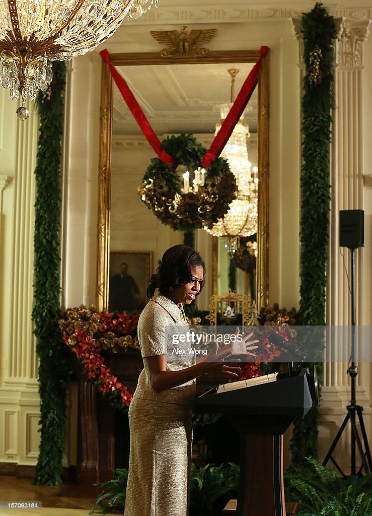 U.S. first lady <a gi-track='captionPersonalityLinkClicked' href=/galleries/search?phrase=Michelle+Obama&family=editorial&specificpeople=2528864 ng-click='$event.stopPropagation()'>Michelle Obama</a> speaks in the East Room during a preview of the 2012 White House holiday decorations November 28, 2012 at the White House in Washington, DC. The first lady welcomed military families, including Gold Star and Blue Star parents, spouses and children, to the White House for the first viewing of the 2012 holiday decorations. The theme for the White House Christmas 2012 is 'Joy to All.'