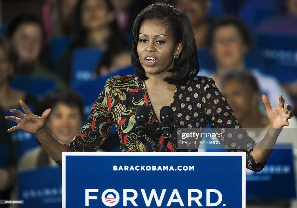 First Lady Michelle Obama speaks to grassroots supporters in Loudoun County on behalf of her husband US President Barack Obama during a campaign rally October 9, 2012 at the Leesburg, Virginia Country Fairgrounds in Leesburg, Virginia. AFP Photo/Paul J. Richards