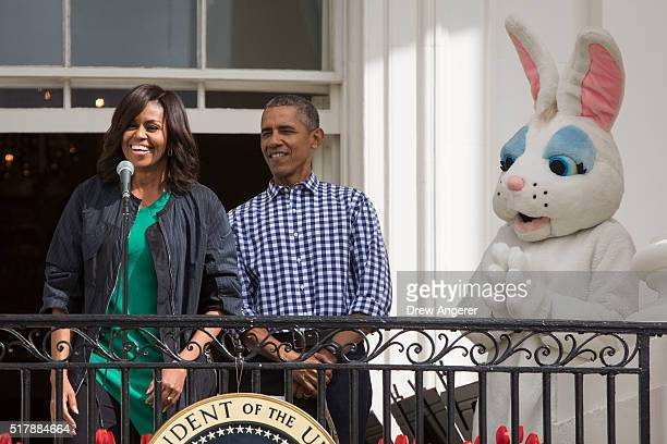 First lady Michelle Obama speaks to the crowd as President Barack Obama looks on during the annual White House Easter Egg Roll on the South Lawn of...