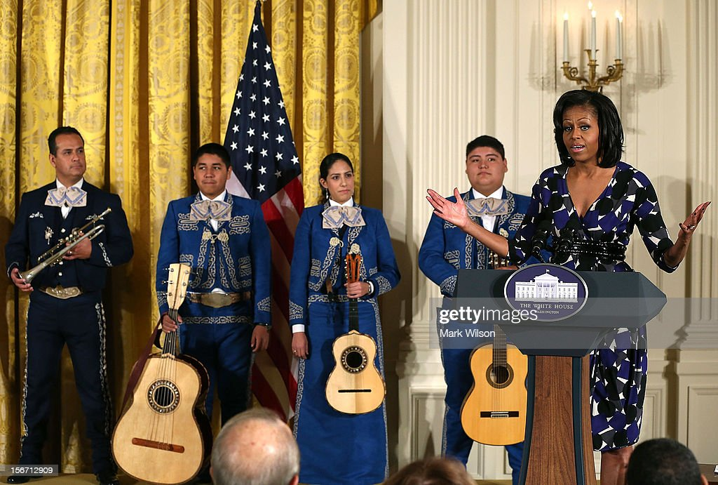 First lady <a gi-track='captionPersonalityLinkClicked' href=/galleries/search?phrase=Michelle+Obama&family=editorial&specificpeople=2528864 ng-click='$event.stopPropagation()'>Michelle Obama</a> speaks while flanked by members of the Mariachi Master Apprentice Program, from San Fernando, Ca., during an awards ceremony for the President's Committee on the Arts and the Humanities in the East Room at the White House on November 19, 2012 in Washington, DC. The first lady talked about the importance of afterschool and out of school arts and humanities education and presented awards recognizing programs across the country that benefit underserved youth.