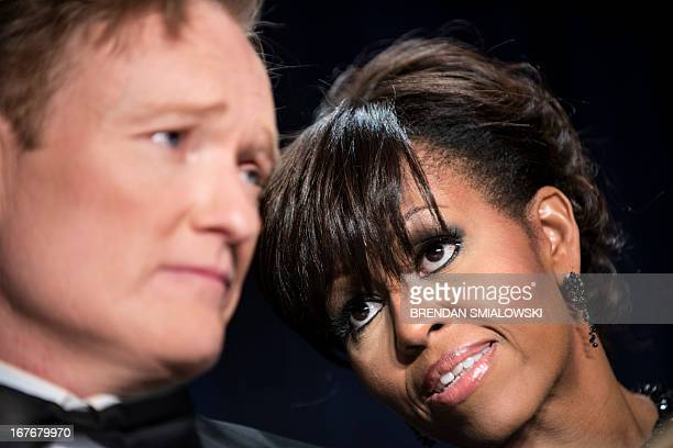 US first lady Michelle Obama speaks with Comedian Conan O'Brien during the White House Correspondents' Association Dinner April 27 2013 in Washington...