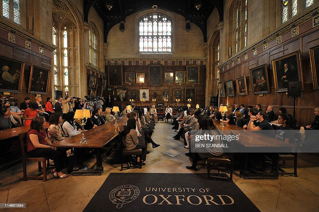 First Lady Michelle Obama speaks with students from the Elizabeth Garrett Anderson School during a visit to Christ Church College at Oxford...