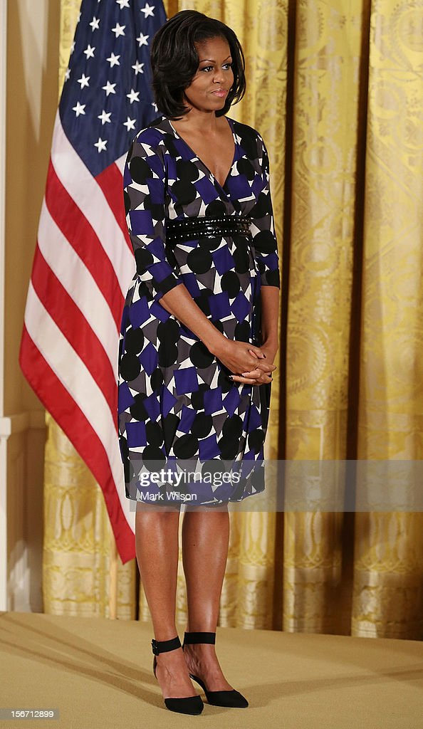 First lady Michelle Obama stands on stage during an awards ceremony for the President's Committee on the Arts and the Humanities in the East Room at the White House on November 19, 2012 in Washington, DC. The first lady talked about the importance of afterschool and out of school arts and humanities education and presented awards recognizing programs across the country that benefit underserved youth.