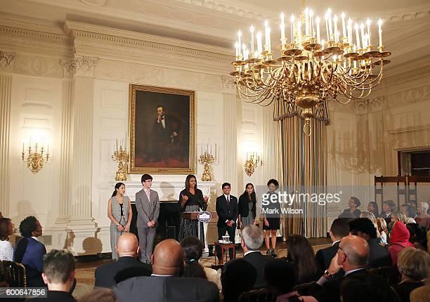 First lady Michelle Obama stands with student poets Maya Salameh Joey Reisberg Gopal Raman Maya Eashwaran and Stella Binion during the President's...