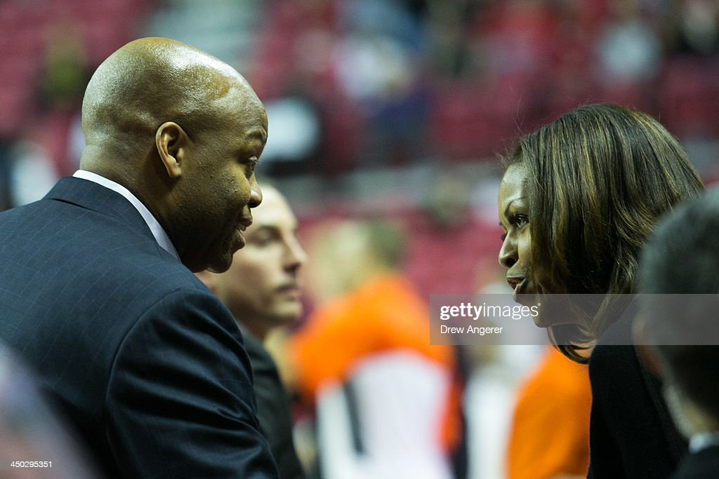 First lady Michelle Obama talks to brother and head coach of Oregon State Craig Robinson during a men's NCCA basketball game between University of...