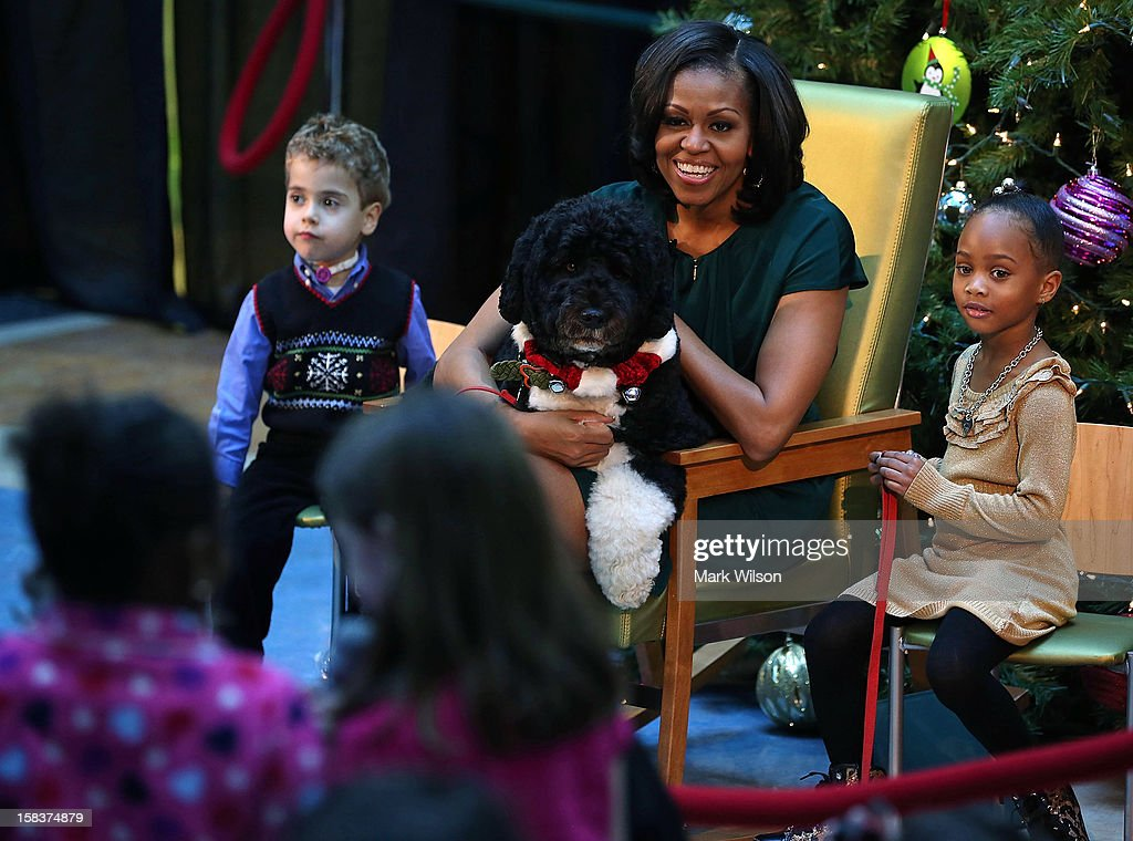 First lady <a gi-track='captionPersonalityLinkClicked' href=/galleries/search?phrase=Michelle+Obama&family=editorial&specificpeople=2528864 ng-click='$event.stopPropagation()'>Michelle Obama</a> talks to children as her dog Bo sits on her lap and 5-year-old AJ Murray (L), and 5-year-old Jordyn Akyoko sit nearby at Children's National Medical Center on December 14, 2012 in Washington, DC. The first lady toured the hospital before greeting 200 patients and hospital staff.