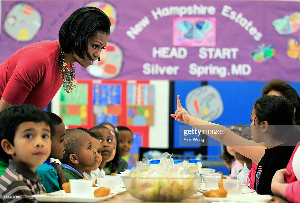 U.S. first lady Michelle Obama (L) talks to Head Start students during lunch as she visits New Hampshire Estates Elementary School, which was awarded the USDA�s Healthier US School Challenge Silver Award in 2009 and partnered with a school in Mexico as part of the Monarch Butterfly Sister School Program, May 19, 2010 in Silver Spring, Maryland. Mrs. Obama toured the school with her Mexican counterpart Margarita Zavala who was on a state visit to Washington with President of Mexico Felipe Calderon.