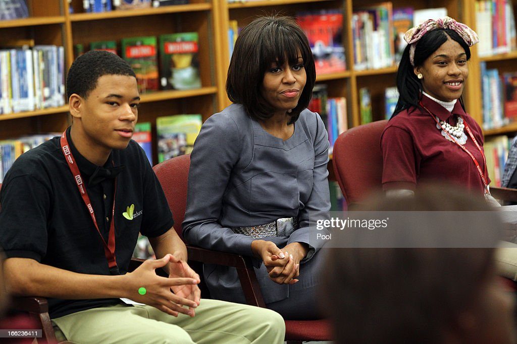 First lady Michelle Obama talks with Joseph Jones, (L) 11th grade and Kayla Pearson, 12th grade, (R) as she visits Harper High School in the Englewood neighborhood to meet with students about the plague of violence in their area April 10, 2013 in Chicago, Illinois. According to published reports Chicago has had 79 murders in 2013. Twenty-seven of the victims have been under 21-years-old, the most recent victim was fourteen-year-old Michael Orozco who died April 7, from two gunshot wounds to his chest. A 17 and a 19-year-old are in custody for Orozco's murder.