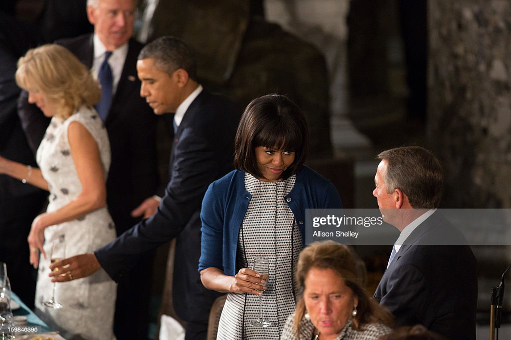 First lady <a gi-track='captionPersonalityLinkClicked' href=/galleries/search?phrase=Michelle+Obama&family=editorial&specificpeople=2528864 ng-click='$event.stopPropagation()'>Michelle Obama</a> talks wtih House Speaker <a gi-track='captionPersonalityLinkClicked' href=/galleries/search?phrase=John+Boehner&family=editorial&specificpeople=274752 ng-click='$event.stopPropagation()'>John Boehner</a> at the Inaugural Luncheon in Statuary Hall on Inauguration day at the U.S. Capitol building January 21, 2013 in Washington D.C. U.S. President <a gi-track='captionPersonalityLinkClicked' href=/galleries/search?phrase=Barack+Obama&family=editorial&specificpeople=203260 ng-click='$event.stopPropagation()'>Barack Obama</a> was ceremonially sworn in for his second term today.