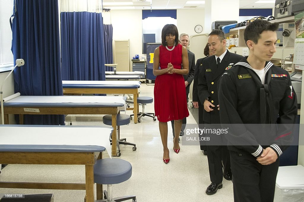US First Lady Michelle Obama tours the Orthopedic Room with sailors in the healthcare professions at the US Naval Academy in Annapolis, Maryland on April 17, 2013. Obama traveled to Annapolis to join Maryland Governor Martin O'Malley at a bill signing for the Veterans Full Employment Act of 2013, supporting military veterans in licensing, training, education and employment. AFP PHOTO / Saul LOEB