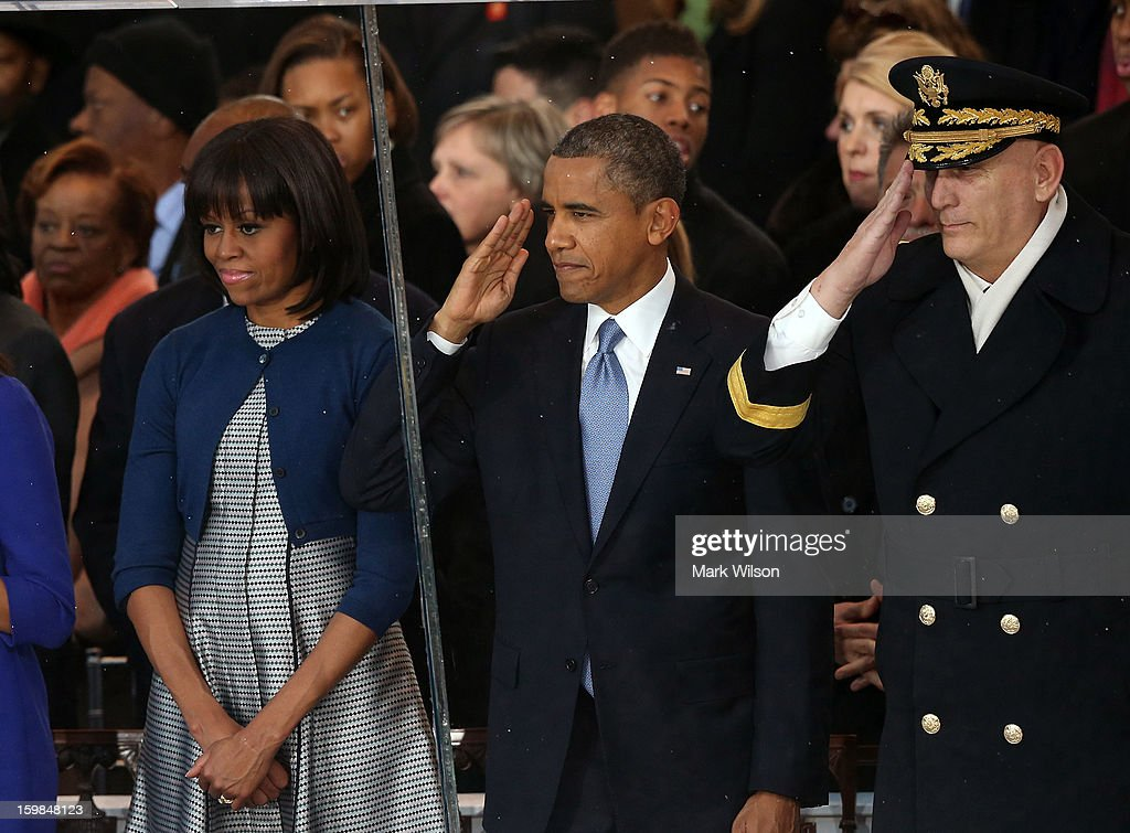 First Lady Michelle Obama, U.S. President Barack Obama, and U.S. Chief of Staff of the Army General Raymond Odierno watch from the reviewing stand as the presidential inaugural parade winds through the nation's capital January 21, 2013 in Washington, DC. Barack Obama was re-elected for a second term as President of the United States.