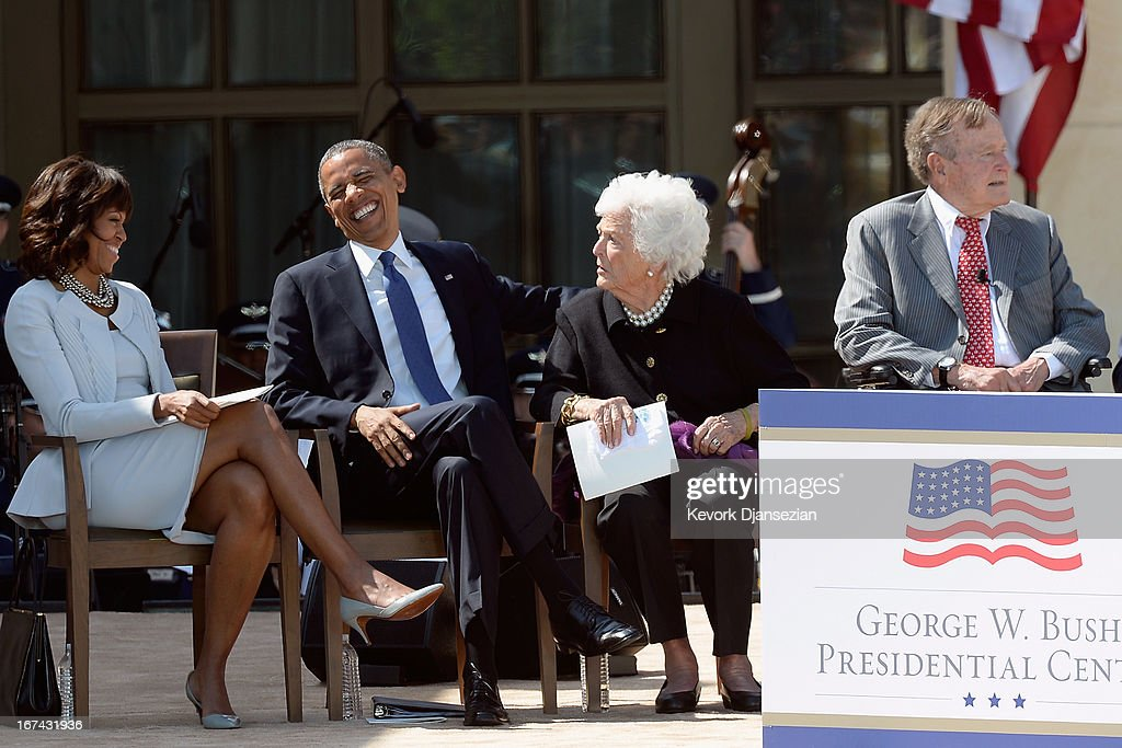 First lady Michelle Obama, U.S. President Barack Obama, former first lady Barbara Bush and former President George H.W. Bush attend the opening ceremony of the George W. Bush Presidential Center April 25, 2013 in Dallas, Texas. The Bush library, which is located on the campus of Southern Methodist University, with more than 70 million pages of paper records, 43,000 artifacts, 200 million emails and four million digital photographs, will be opened to the public on May 1, 2013. The library is the 13th presidential library in the National Archives and Records Administration system.