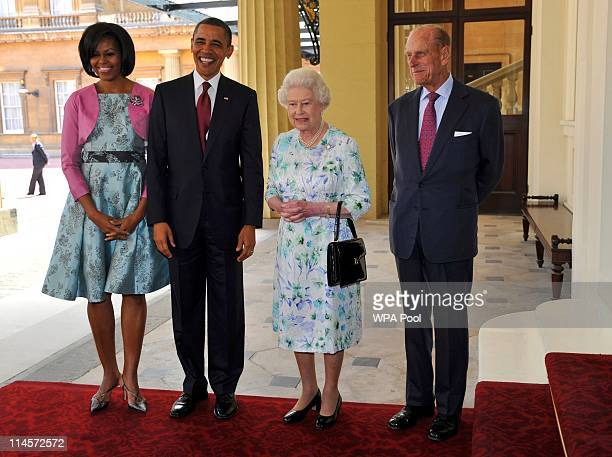 First Lady Michelle Obama US President Barack Obama Queen Elizabeth II and Prince Philip Duke of Edinburgh pose for a photo as they arrive to...